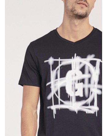 T-shirt con stampa spray...